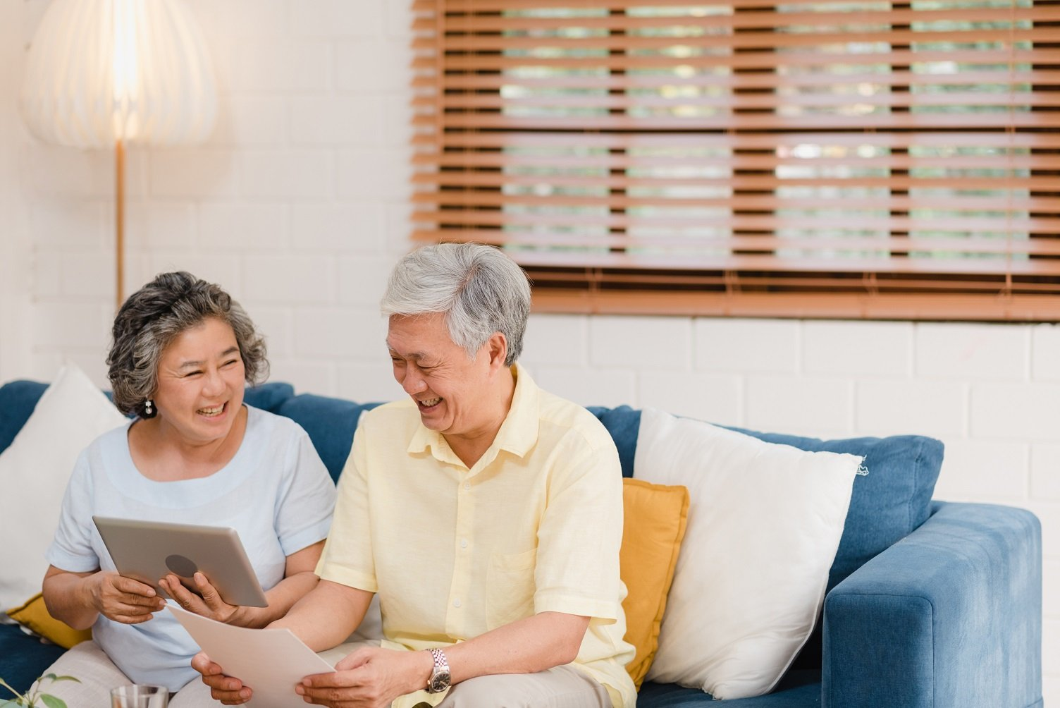Asian elderly couple planning their retirement